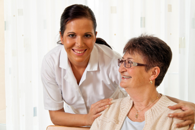 female caregiver holding the shoulder of senior woman