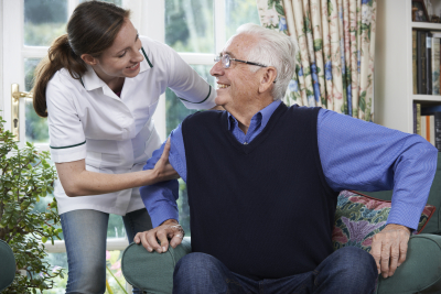 female caregiver assisting elderly man